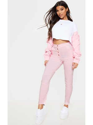 PrettyLittleThing pastel pink button front high waisted skinny pants