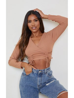 PrettyLittleThing rib cross over ruched drawstring waist long sleeve crop top