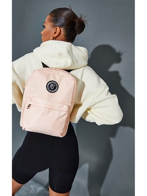 PrettyLittleThing round badge backpack