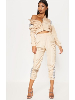 PrettyLittleThing stripe shell tracksuit top