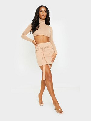 PrettyLittleThing tan lightweight knit tie front mini skirt