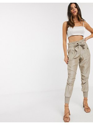 River Island ruched satin tie waist jogger pants in beige-pink