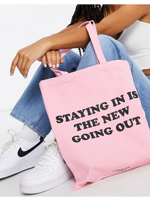 Skinnydip canvas tote bag in pink with staying in slogan