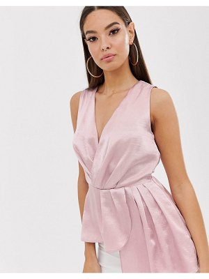 The Girlcode satin asymmetric wrap top in blush