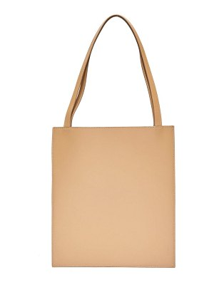 The Row flat logo-debossed leather tote bag