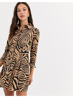 Wednesday's Girl mini shirt dress with pleated skirt in animal print-beige
